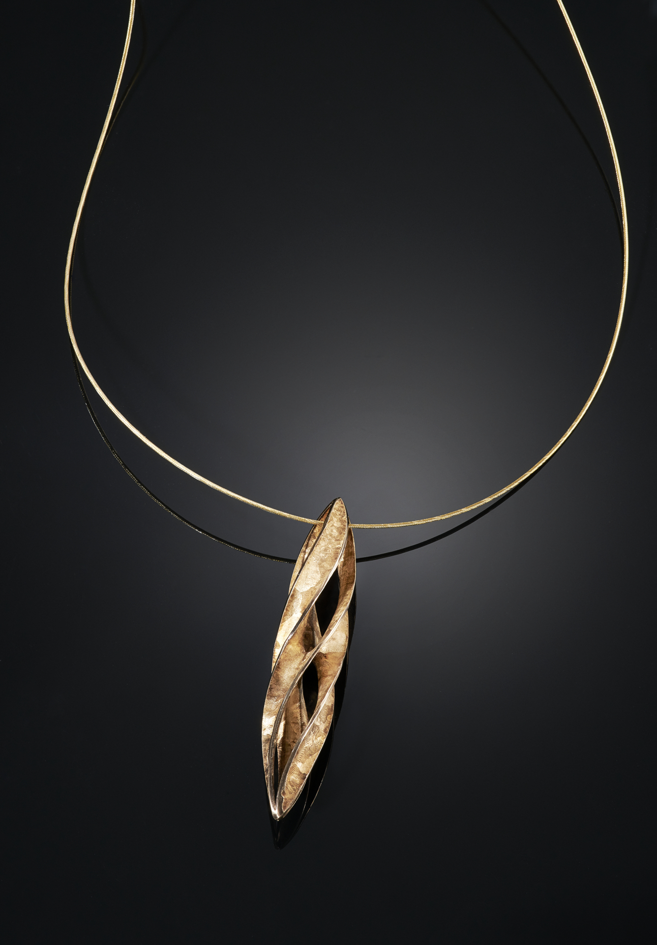 gold-over-cast-crystalline-bronze-enneper-twist-pendant